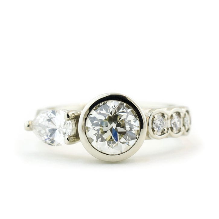 Wide Band Engagement Ring With Diamonds